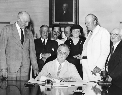 Roosevelt signing the Social Security Bill