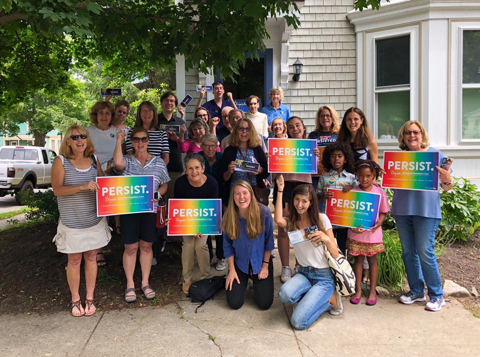 "Group of canvassers who attended a canvassing event in Newburyport holding rainbow signs that say ""PERSIST"""