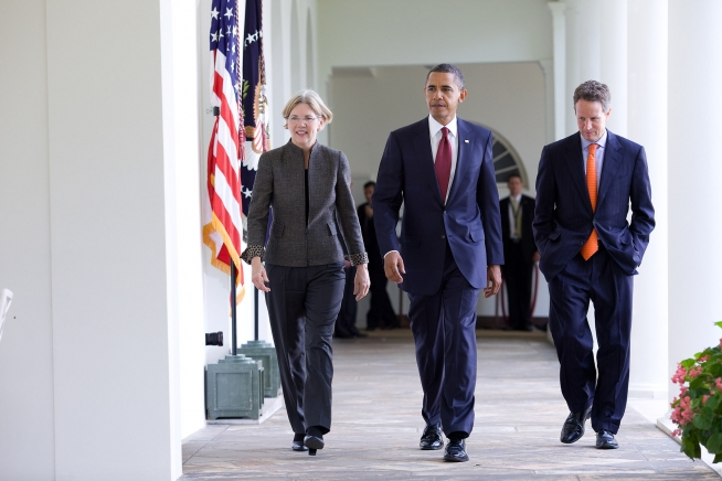 Elizabeth Warren walking with Barack Obama and another man at the White House